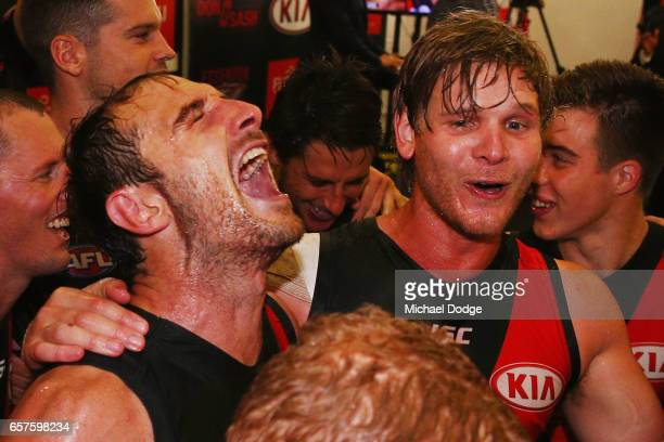 Jobe Watson and Michael Hurley of the Bombers sing the club song after winning during the round one AFL match between the Essendon Bombers and the...