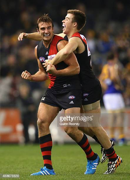 Jobe Watson and Zach Merrett of the Bombers celebrate winning the round 21 AFL match between the Essendon Bombers and the West Coast Eagles at Etihad...