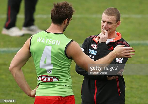 Jobe Watson gestures to interim senior coach Simon Goodwin during an Essendon Bombers training session at Windy Hill on August 30 2013 in Melbourne...