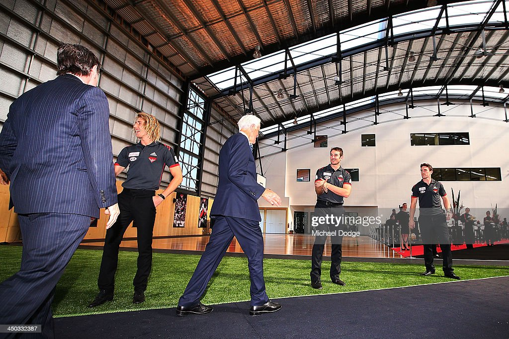 Jobe Watson greets former player Jack Jones at the official launch the new Essendon Bombers AFL training facility at Tullamarine on November 18, 2013 in Melbourne, Australia.