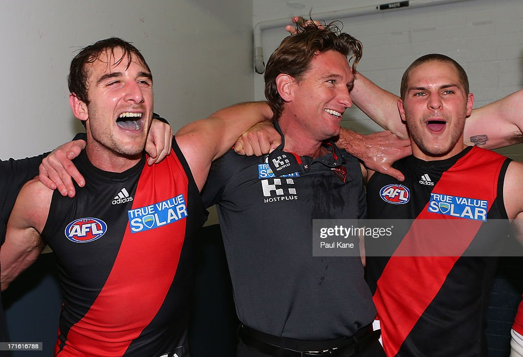<a gi-track='captionPersonalityLinkClicked' href=/galleries/search?phrase=Jobe+Watson&family=editorial&specificpeople=235888 ng-click='$event.stopPropagation()'>Jobe Watson</a>, <a gi-track='captionPersonalityLinkClicked' href=/galleries/search?phrase=James+Hird&family=editorial&specificpeople=201975 ng-click='$event.stopPropagation()'>James Hird</a> and <a gi-track='captionPersonalityLinkClicked' href=/galleries/search?phrase=David+Zaharakis&family=editorial&specificpeople=5629221 ng-click='$event.stopPropagation()'>David Zaharakis</a> of the Bombers sing the club song after winning the round 14 AFL match between the West Coast Eagles and the Essendon Bombers at Patersons Stadium on June 27, 2013 in Perth, Australia.