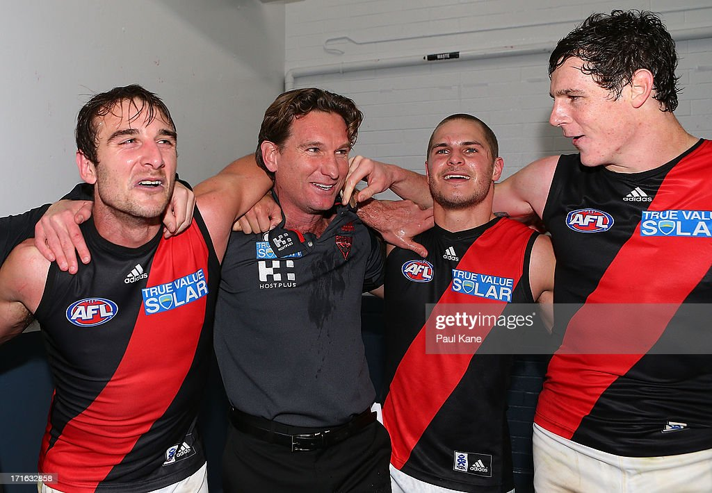 <a gi-track='captionPersonalityLinkClicked' href=/galleries/search?phrase=Jobe+Watson&family=editorial&specificpeople=235888 ng-click='$event.stopPropagation()'>Jobe Watson</a>, <a gi-track='captionPersonalityLinkClicked' href=/galleries/search?phrase=James+Hird&family=editorial&specificpeople=201975 ng-click='$event.stopPropagation()'>James Hird</a>, <a gi-track='captionPersonalityLinkClicked' href=/galleries/search?phrase=David+Zaharakis&family=editorial&specificpeople=5629221 ng-click='$event.stopPropagation()'>David Zaharakis</a> and Jake Carlisle of the Bombers sing the club song after winning the round 14 AFL match between the West Coast Eagles and the Essendon Bombers at Patersons Stadium on June 27, 2013 in Perth, Australia.