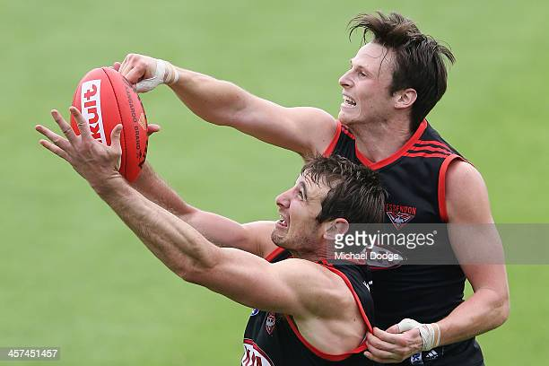 Jobe Watson marks the ball against Andrew Browne during an Essendon Bombers AFL preseason training session at True Vaule Solar Centre on December 18...