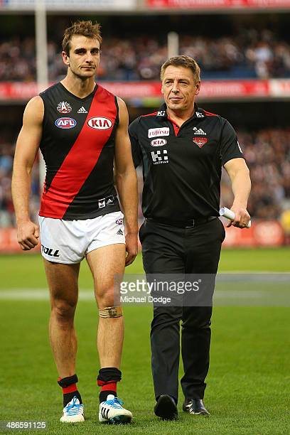 Jobe Watson of the Bombers and coach Mark Thompson walk off after their defeat during the round six AFL match between the Collingwood Magpies and the...