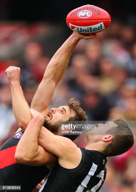 Jobe Watson of the Bombers and Matthew Scharenberg of the Magpies compete for the ball during the round 16 AFL match between the Collingwood Magpies...