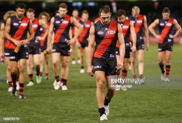 Jobe Watson of the Bombers and the team walk off after losing during the round eight AFL match between the Essendon Bombers and the Brisbane Lions at...