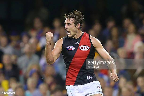 Jobe Watson of the Bombers celebrates a goal during the round eight AFL match between the Brisbane Lions and the Essendon Bombers at The Gabba on May...