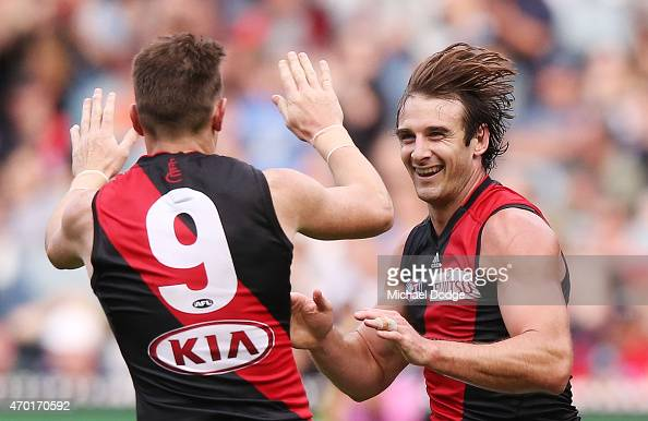 Jobe Watson of the Bombers celebrates a goal with Brendon Goddard during the round three AFL match between the Carlton Blues and the Essendon Bombers...