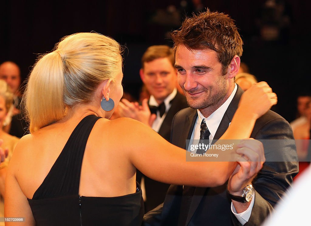 <a gi-track='captionPersonalityLinkClicked' href=/galleries/search?phrase=Jobe+Watson&family=editorial&specificpeople=235888 ng-click='$event.stopPropagation()'>Jobe Watson</a> of the Bombers hugs partner Ella Keddie after winning the Brownlow Medal during the 2012 Brownlow Medal at Crown Palladium on September 24, 2012 in Melbourne, Australia.