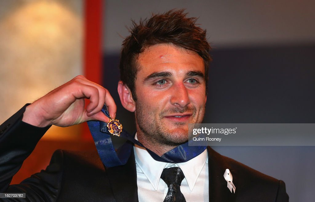 <a gi-track='captionPersonalityLinkClicked' href=/galleries/search?phrase=Jobe+Watson&family=editorial&specificpeople=235888 ng-click='$event.stopPropagation()'>Jobe Watson</a> of the Bombers poses with the Brownlow Medal during the 2012 Brownlow Medal at Crown Palladium on September 24, 2012 in Melbourne, Australia.