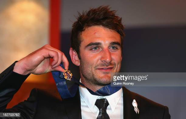 Jobe Watson of the Bombers poses with the Brownlow Medal during the 2012 Brownlow Medal at Crown Palladium on September 24 2012 in Melbourne Australia