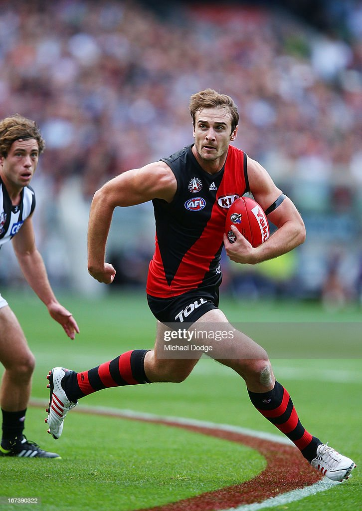 Jobe Watson of the Bombers runs with the ball during the round five AFL match between the Essendon Bombers and the Collingwood Magpies at Melbourne Cricket Ground on April 25, 2013 in Melbourne, Australia.
