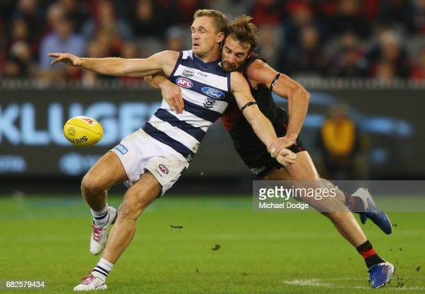 Jobe Watson of the Bombers tackles Joel Selwood of the Cats during the round eight AFL match between the Essendon Bombers and the Geelong Cats at...