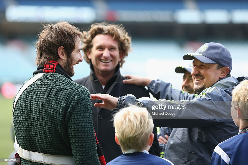 Jobe Watson of the Essendon Bombers (L) and Bombers head coach James Hird react with Real Mardid Head Manager Rafa Benitez (R) after a Real Madrid training session at Melbourne Cricket Ground on July 17, 2015 in Melbourne, Australia.
