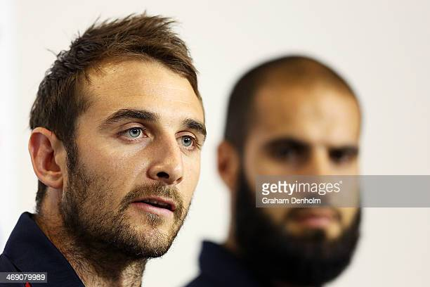 Jobe Watson of the Essendon Bombers talks to the media as Bachar Houli of the Richmond Tigers looks on during the launch of the AFL Multicultural...