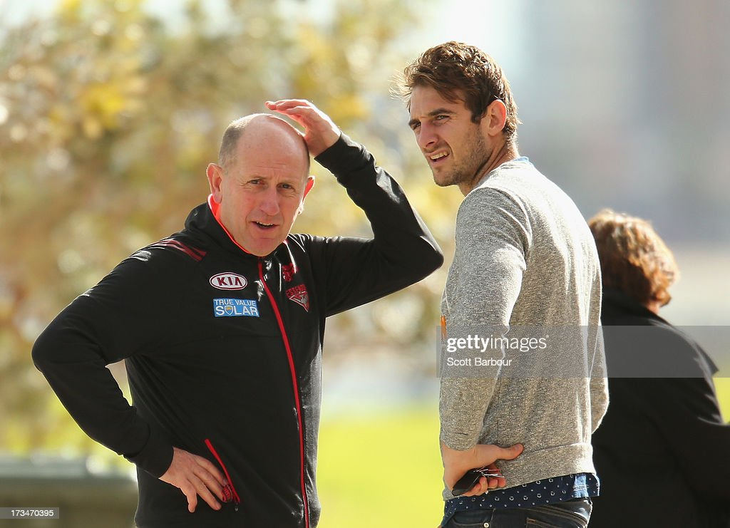 Jobe Watson (R) of the Essendon Bombers walks past during a Carlton Blues AFL Recovery Session at St Kilda Sea Baths on July 15, 2013 in Melbourne, Australia.