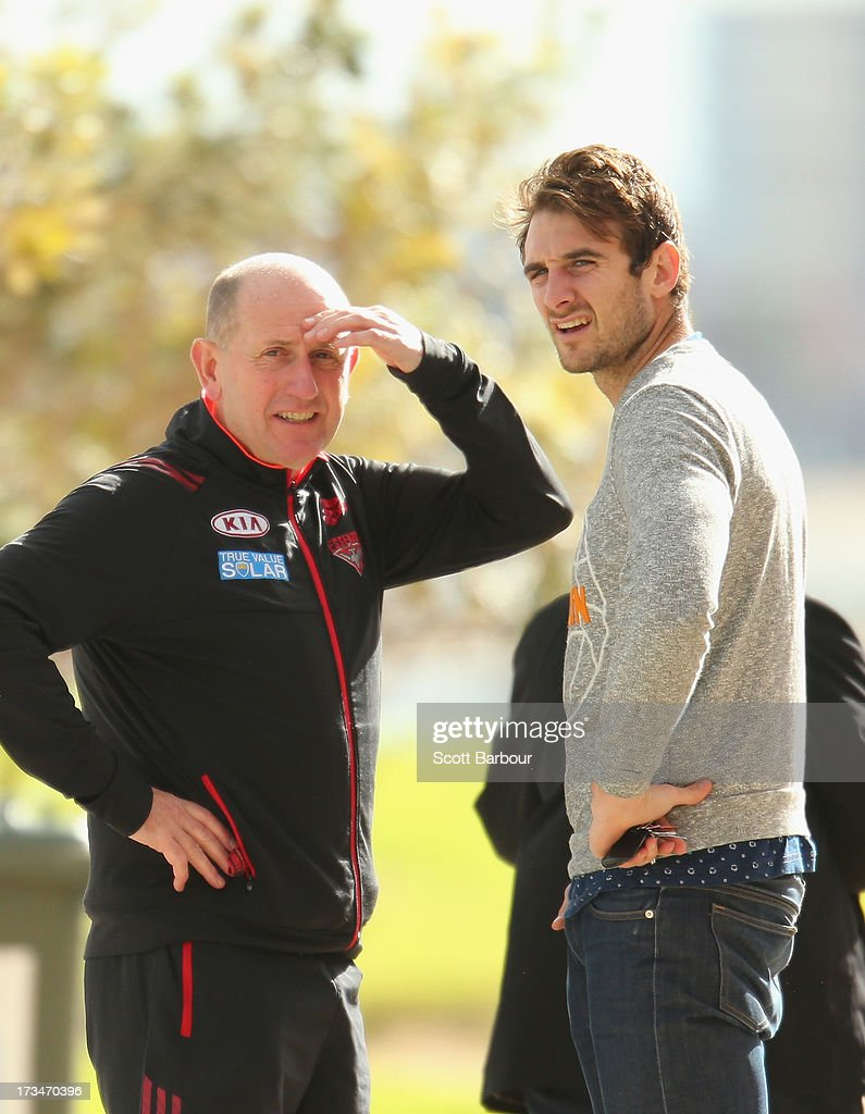 <a gi-track='captionPersonalityLinkClicked' href=/galleries/search?phrase=Jobe+Watson&family=editorial&specificpeople=235888 ng-click='$event.stopPropagation()'>Jobe Watson</a> (R) of the Essendon Bombers walks past during a Carlton Blues AFL Recovery Session at St Kilda Sea Baths on July 15, 2013 in Melbourne, Australia.