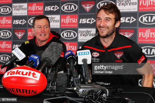 Jobe Watson reacts with head coach John Worsfold as he speaks to the media announcing his retirement at the Essendon Football Club on August 9 2017...
