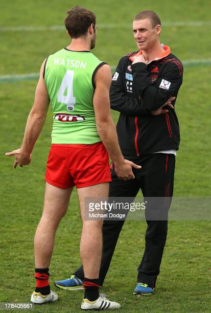 Jobe Watson speaks to interim senior coach Simon Goodwin during an Essendon Bombers training session at Windy Hill on August 30 2013 in Melbourne...