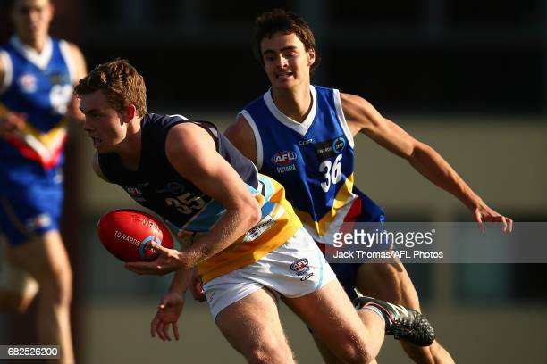 Jobee Warde of the Pioneers runs with the ball during the round seven TAC Cup match between the Eastern Ranges and the Bendigo Pioneers at Box Hill...