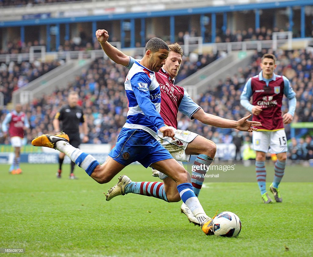 Jobi McAnfuff of Reading tackled by Nathan Baker of Aston Villa during the Premier League match between Reading and Aston Villa at Madejski Stadium on March 9, 2013 in Reading, England.