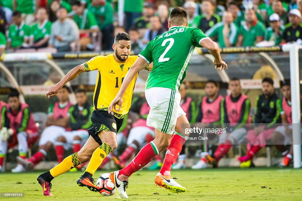 <a gi-track='captionPersonalityLinkClicked' href=/galleries/search?phrase=Jobi+McAnuff&family=editorial&specificpeople=642949 ng-click='$event.stopPropagation()'>Jobi McAnuff</a> #10 of Jamaica takes on <a gi-track='captionPersonalityLinkClicked' href=/galleries/search?phrase=Nestor+Araujo&family=editorial&specificpeople=7201527 ng-click='$event.stopPropagation()'>Nestor Araujo</a> #2 of Mexico during the Copa America Centenario Group C match between Mexico and Jamaica at the Rose Bowl on June 9, 2016 in Pasadena, California. Mexico won the match 2-0.