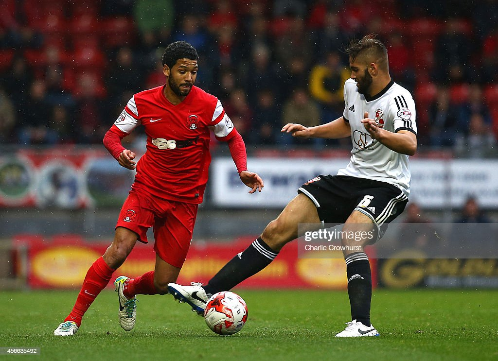 <a gi-track='captionPersonalityLinkClicked' href=/galleries/search?phrase=Jobi+McAnuff&family=editorial&specificpeople=642949 ng-click='$event.stopPropagation()'>Jobi McAnuff</a> of Leyton Orient is block by Jordan Turnball of Swindon during the Sky Bet League One match between Leyton Orient and Swindon Town at The Matchroom Stadium on October 04, 2014 in London, England.