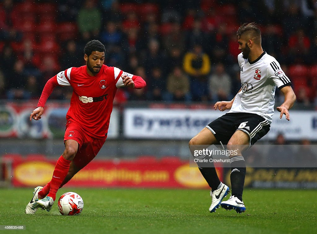 <a gi-track='captionPersonalityLinkClicked' href=/galleries/search?phrase=Jobi+McAnuff&family=editorial&specificpeople=642949 ng-click='$event.stopPropagation()'>Jobi McAnuff</a> of Leyton Orient looks to get past Jordan Turnball of Swindon during the Sky Bet League One match between Leyton Orient and Swindon Town at The Matchroom Stadium on October 04, 2014 in London, England.