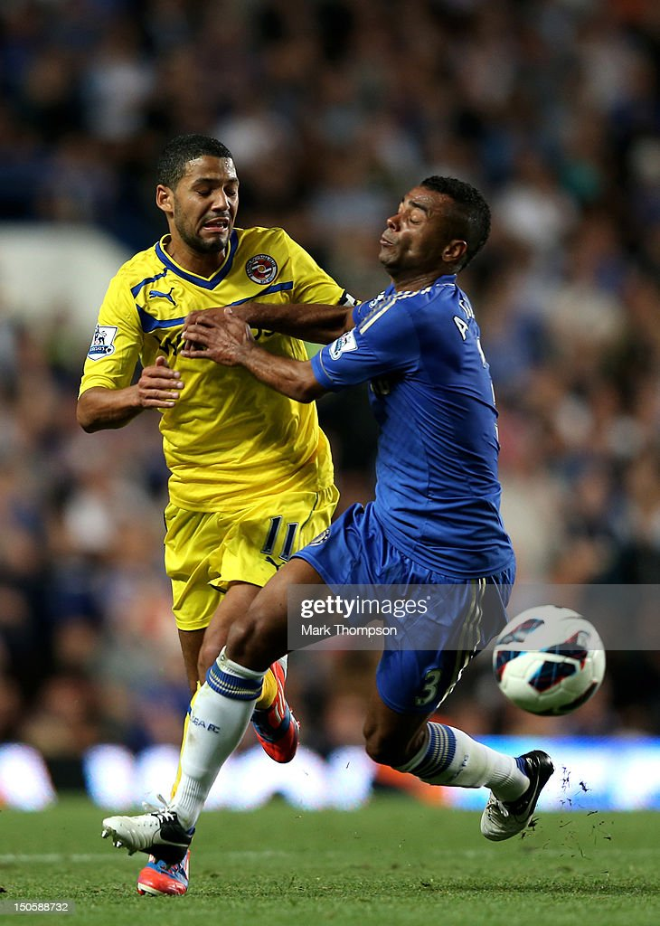 Jobi McAnuff of Reading and <a gi-track='captionPersonalityLinkClicked' href=/galleries/search?phrase=Ashley+Cole&family=editorial&specificpeople=201831 ng-click='$event.stopPropagation()'>Ashley Cole</a> of Chelsea battle for the ball during the Barclays Premier League match between Chelsea and Reading at Stamford Bridge on August 22, 2012 in London, England.