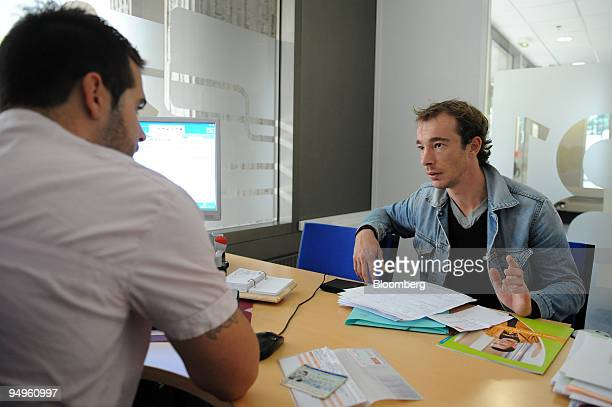 Jobseeker Alexy Minot right is interviewed at a Pole Emploi unemployment office in Paris France on Wednesday Sept 23 2009 French monthly unemployment...