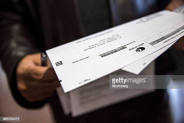 A jobseeker checks their documentation inside a Pole Emploi job center the French national employment agency in Montauban France on Tuesday March 3...