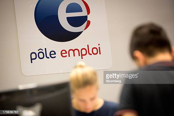 A jobseeker right speaks to a job adviser inside a Pole Emploi the French national employment center in Strasbourg France on Friday Aug 2 2013 The...
