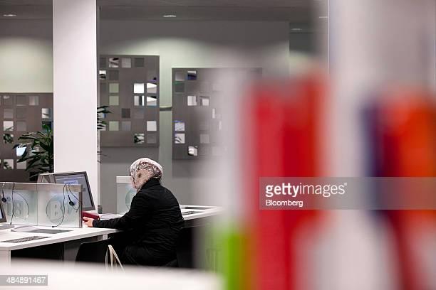 A jobseeker sits at a desktop computer inside a Agentur fuer Arbeit employment office in Stuttgart Germany on Monday April 14 2014 German...