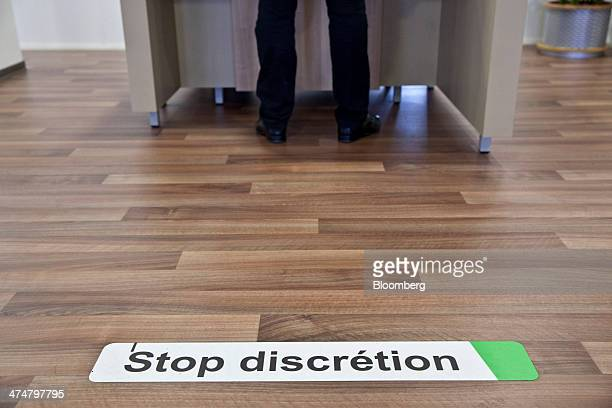 A jobseeker stands at a service desk inside a Pole Emploi job center the French national employment agency in Montpellier France on Tuesday Feb 25...