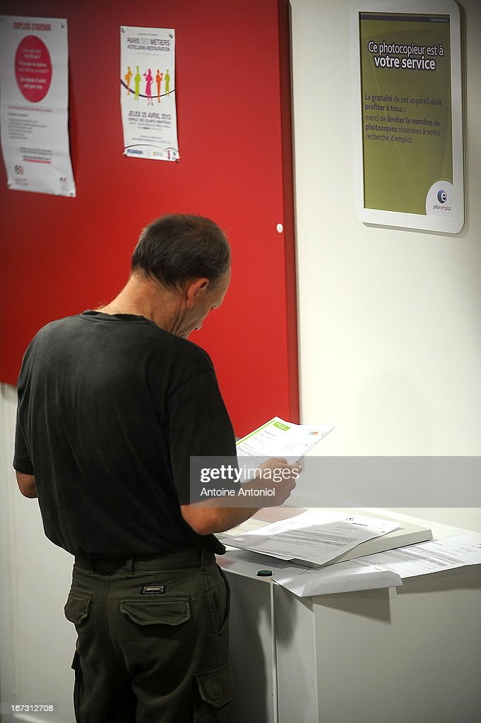 A jobseeker uses a free photocopier at a Pole Emploi unemployment office on April 24, 2013 in Vincennes, France. French unemployment keeps rising and the number of unemployed people could reach a new historical record in May 2013.