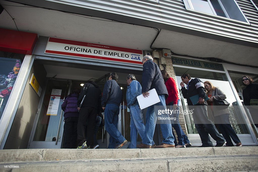 Jobseekers enter an employment office after opening in Madrid, Spain, on Thursday, April 25, 2013. Spanish unemployment rose more than economists forecast in the first quarter to the highest in at least 37 years as efforts to tackle the European Union's biggest budget deficit crimped economic growth. Photographer: Angel Navarrete/Bloomberg via Getty Images