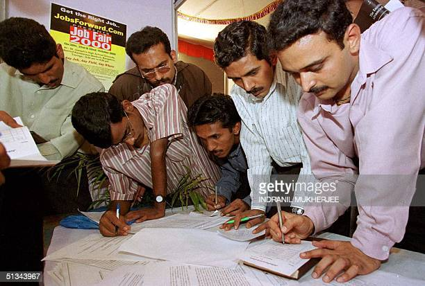 Jobseekers fills up registration forms at 'Job Fair 2000' in Bangalore 22 October 2000 The fair organized by a leading Indian employment portal...