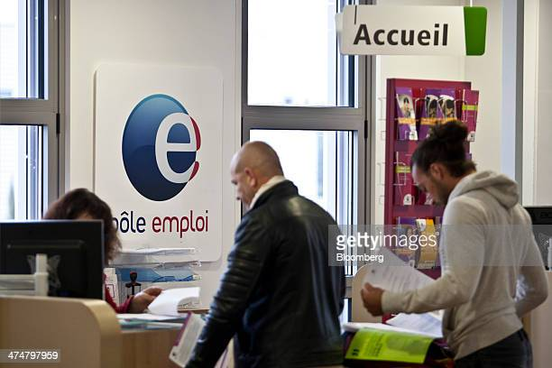 Jobseekers hold documents as they wait to be served inside a Pole Emploi job center the French national employment agency in Montpellier France on...