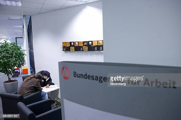 Jobseekers look at documents inside a Agentur fuer Arbeit employment office in Stuttgart Germany on Monday April 14 2014 German unemployment fell for...