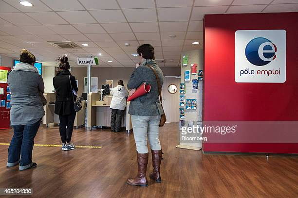 Jobseekers queue at service desks inside a Pole Emploi job center the French national employment agency in Montauban France on Tuesday March 3 2015...