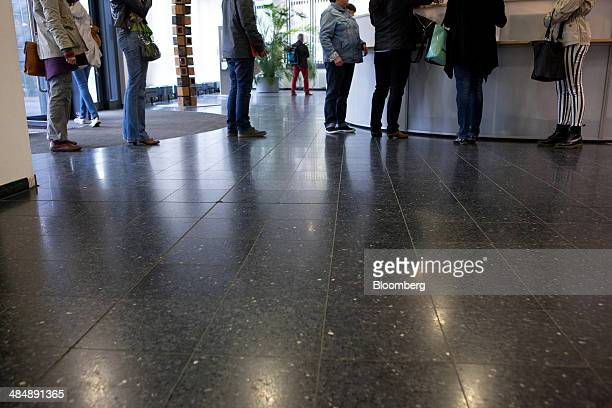 Jobseekers queue at the reception area inside a Agentur fuer Arbeit employment office in Stuttgart Germany on Monday April 14 2014 German...