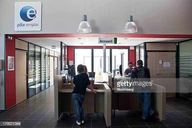 Jobseekers stand at service desks inside a job center also known as Pole Emploi the French national employment center in Castelginest France on...