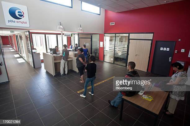 Jobseekers wait for service inside a job center also known as Pole Emploi the French national employment center in Castelginest France on Wednesday...