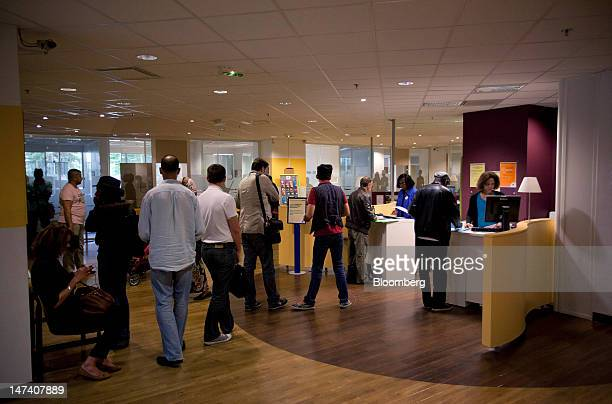 Jobseekers wait in line at a French job center or pole emploi in Paris France on Friday June 29 2012 Economic confidence in the euro area slumped to...