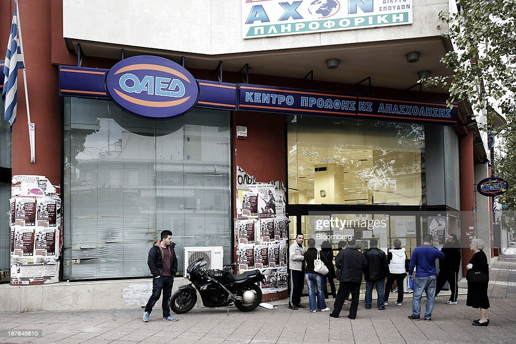 Jobseekers wait outside an OAED employment center ahead of opening in Thessaloniki, Greece, on Wednesday, Nov. 13, 2013. Greece 'is following a fiscal adjustment program that aims to make the country's public finances sustainable on a permanent basis,' Finance Minister Yannis Stournaras told lawmakers during the debate, after holding talks with the troika earlier in the week. Photographer: Konstantinos Tsakalidis/Bloomberg via Getty Images