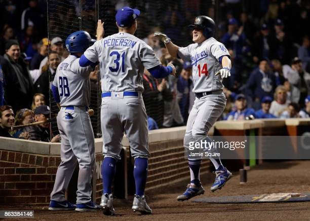 Joc Pederson and Enrique Hernandez of the Los Angeles Dodgers celebrate after Hernandez hit a home run in the ninth inning against the Chicago Cubs...