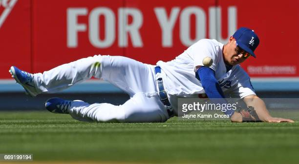 Joc Pederson of the Los Angeles Dodgers can't handle a single hit by Chris Owings of the Arizona Diamondbacks in the fifth inning of the game at...