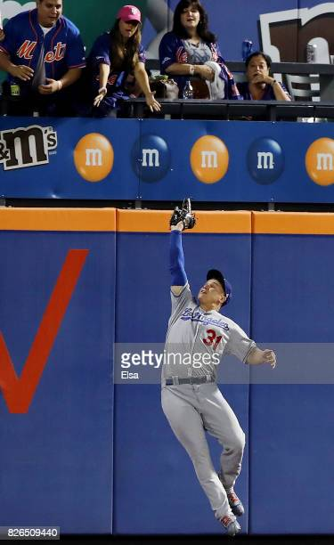 Joc Pederson of the Los Angeles Dodgers catches a hit by Neil Walker of the New York Mets to end the game on August 4 2017 at Citi Field in the...