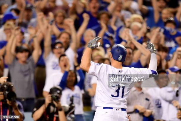 Joc Pederson of the Los Angeles Dodgers celebrates after hitting a solo home run during the fifth inning against the Houston Astros in game two of...