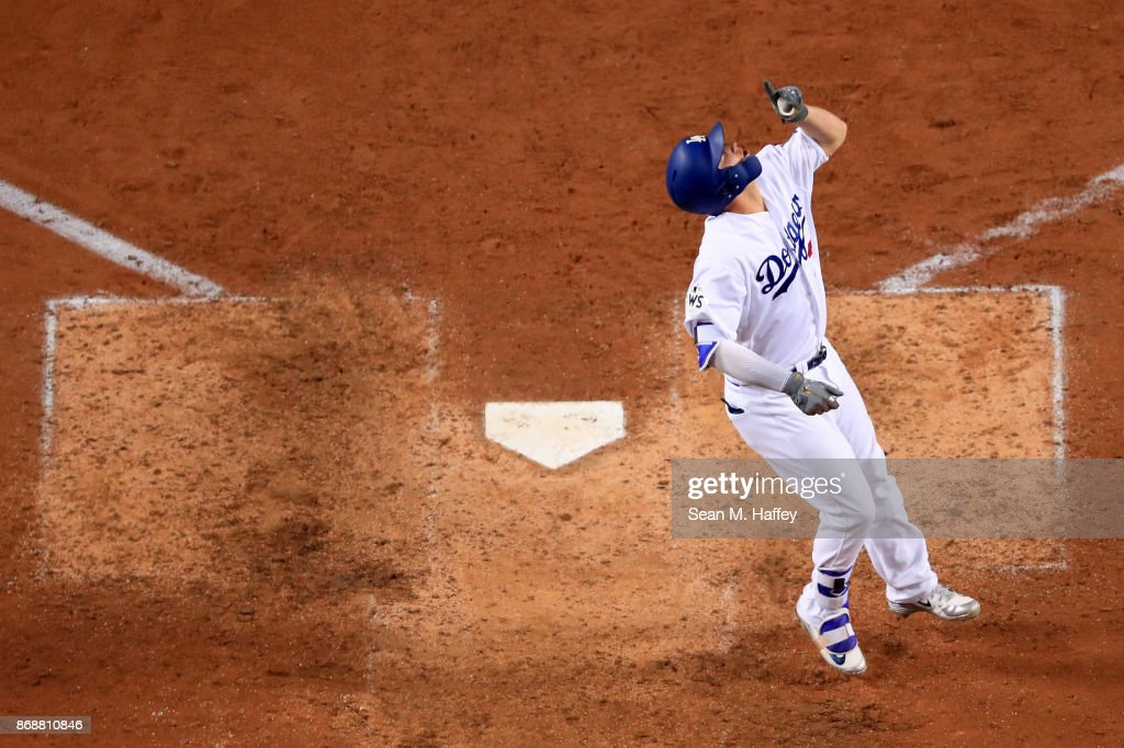 Joc Pederson #31 of the Los Angeles Dodgers celebrates after hitting a solo home run during the seventh inning against the Houston Astros in game six of the 2017 World Series at Dodger Stadium on October 31, 2017 in Los Angeles, California.